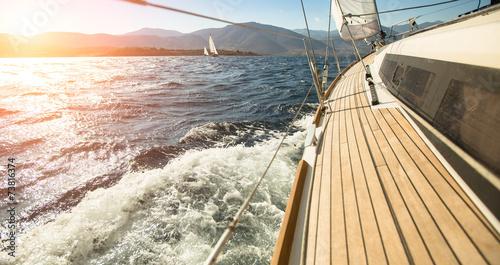 Stampa su Tela Yacht sailing towards the sunset. Sailing. Luxury yachts.