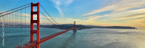 Photo Golden Gate Bridge panorama, San Francisco California, sunset light on cloudy sk