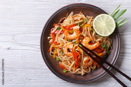 Rice noodles with shrimps and vegetables top view