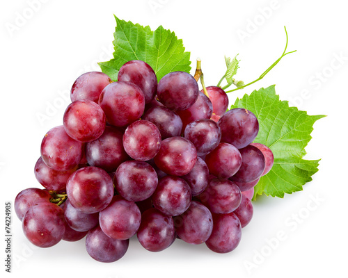 Canvas Print Ripe red grape with leaves isolated on white