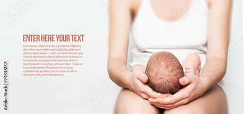 newborn baby in lap