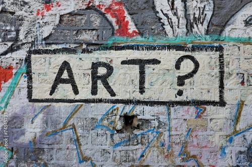 Fotografia Art ? Graffiti sur mur de briques dans la rue.