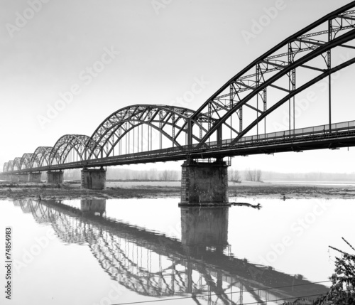 Gerola Bridge on the Po river, wintertime. BW image #74854983
