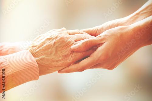 Fotografie, Obraz Helping hands, care for the elderly concept