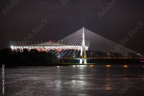 Night view of bridge and stadium in Warsaw #75849922