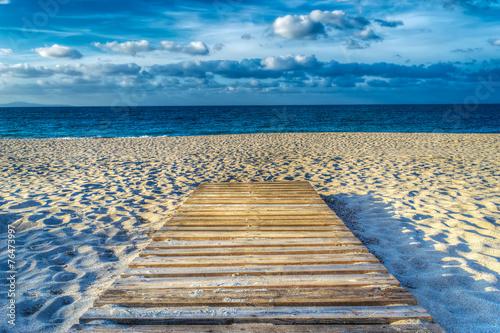 wooden boardwalk on the sand in hdr Fototapeta