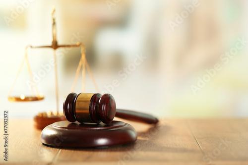 Wooden judges gavel on wooden table, close up Fototapeta