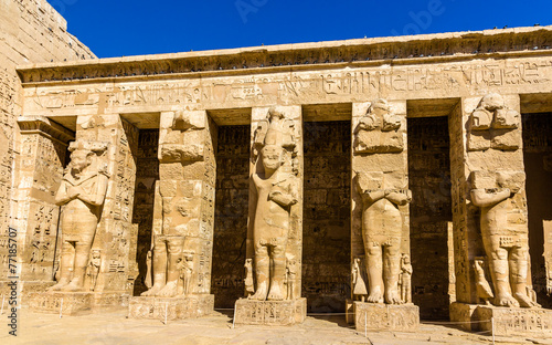 Ancient figures in the Medinet Habu temple - Egypt #77185707