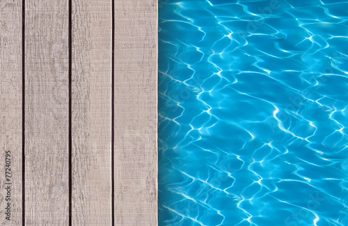 Fényképezés Swimming pool and wooden deck ideal for backgrounds