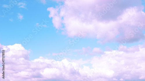 Blue sky background with purple clouds