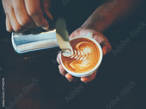 Leinwand Poster Tasse Kaffee Latte Art in Coffee-Shop