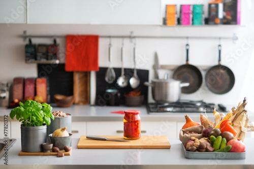 Closeup on table with vegetables in kitchen