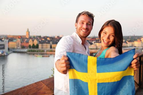 Wallpaper Mural Swedish people showing Sweden flag in Stockholm