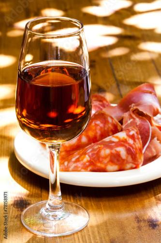 Fotografie, Obraz Glass of sherry with a snack (ham, jamon, parma).