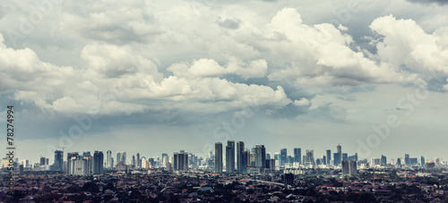 Jakarta city view with Kampung in foreground