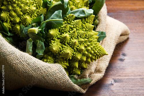 Stampa su Tela Romanesco broccoli cabbage on wood