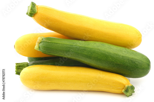 mixed yellow and green zucchini's on a white background