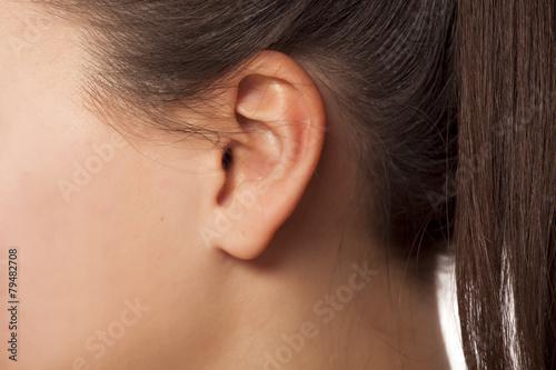 Foto Close up of female ear