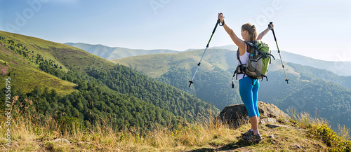 Fotografie, Obraz Young woman hiking in the mountains