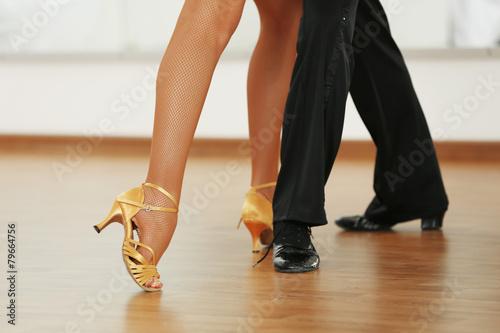 Beautiful womanish and masculine legs in active ballroom dance, Fototapet