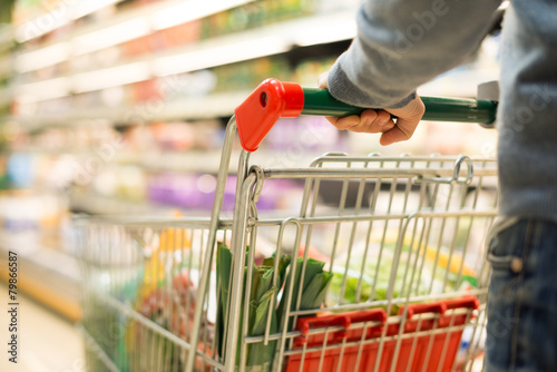 Detail of a man shopping in a supermarket