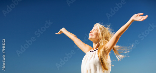 Stampa su Tela beautiful woman enjoying summer outdoors