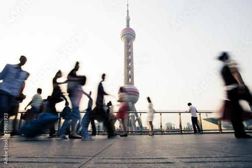 landmark and walking people in Shanghai.