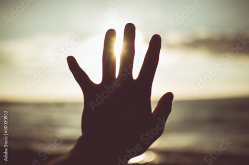 Obraz na płótnie Hand to sun. Element of design, vintage tone color