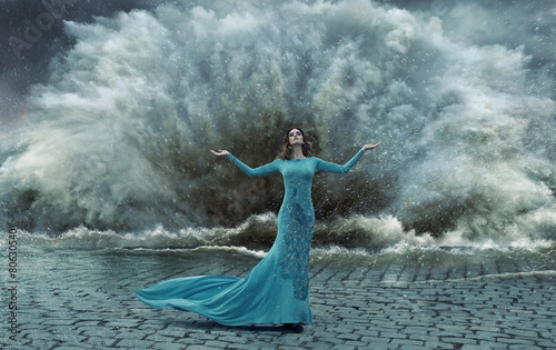Obraz na plátne Alluring, elegant woman over the sand&water storm