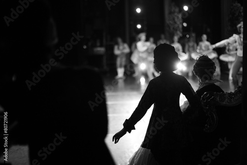 Silhouettes of actors waiting in the wings