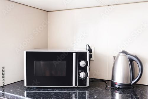 Close-up microwave and stainless electric kettle