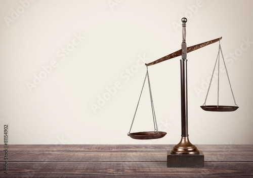 Canvas Print Lawyer. Law scales on table in front black background. Symbol of