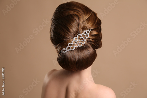 woman with elegant retro hairstyle with hair accessory Fototapeta