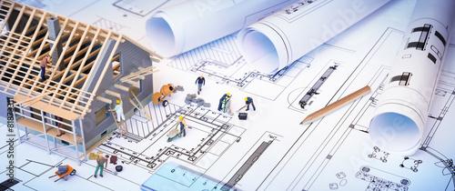 Fotografiet house under construction on blueprints - building project