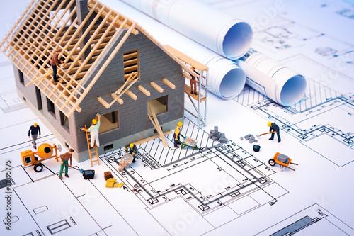 building house on blueprints with worker - construction project Tapéta, Fotótapéta