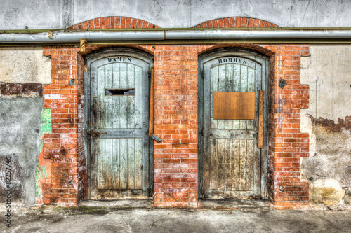 Old toilet doors in an abandoned factory