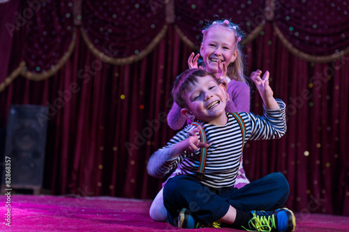 Canvas Print Two funny children acting as monsters on stage