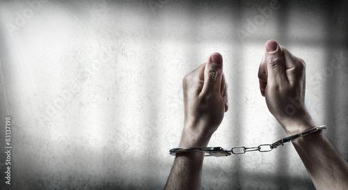 Fotografía arrest  - man handcuffed in cell prison