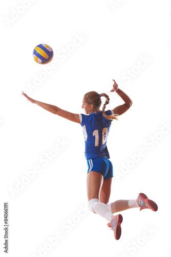 Fototapeta Volejbal žena skákat a kopat míč na bílém pozadí