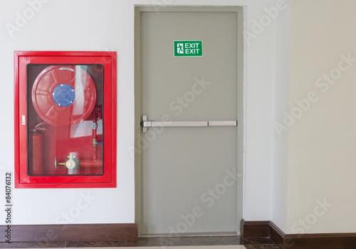 Slika na platnu Fire exit door and fire extinguish equipment