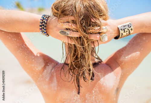 Blonde woman with sandy hair by the beach