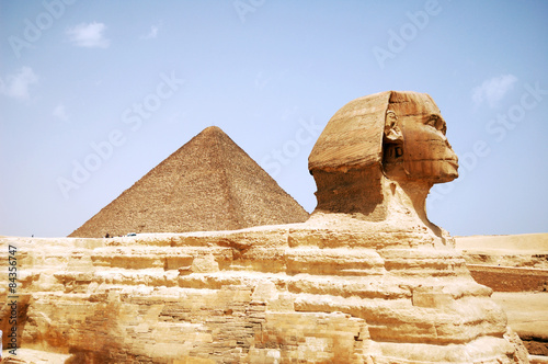Sphinx Head / Sphinx Head and pyramid on Giza, Egypt #84356747
