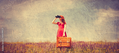 Fotografia, Obraz girl in red dress with suitcase and binocular