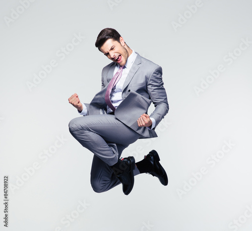Fototapeta Funny businessman jumping in air