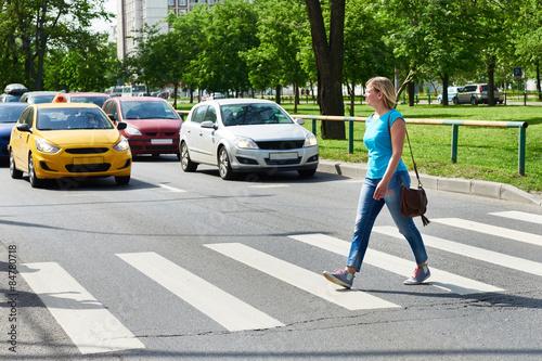 Obraz na plátne Woman crossing street at pedestrian crossing