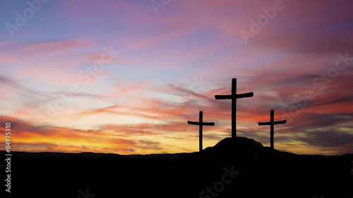 Canvas Print three crosses in silhouette on a hill with sunset