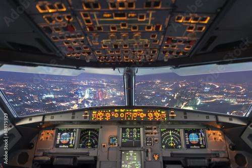 plane cockpit and city of night Fototapet