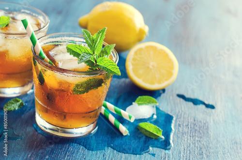 Fresh cold iced tea with mint, ice and lemons, refreshing drink, Fototapeta
