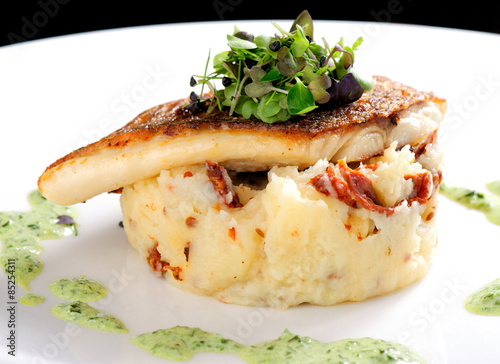 Tablou Canvas Tasty healthy fish fillet with potato puree with dried tomatoes and wild garlic