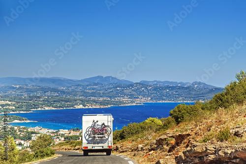 Obraz na płótnie Caravan RV camper van on the road at the mediterranean shore